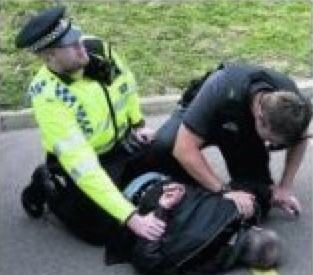 Police arresting the burglar