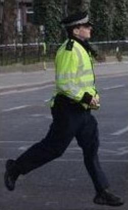 Police arriving at the scene of a break in